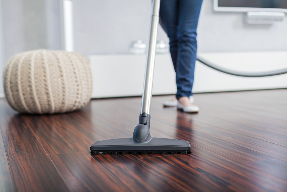 Cleaning the house with a hoover